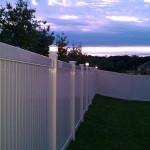 6 foot tall vinyl fence with lit post caps installed in Hudsonville, MI