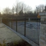Ornamental Aluminum Pool Fence between Stone pillars