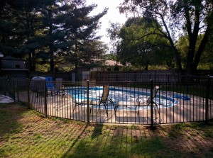 "48"" tall 3 rail ornamental aluminum in Bronze installed poolside in Zeeland, MI"